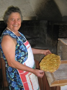 Signora Giuseppa enjoys the fruits of her labor - homemade foccacia baked in the wood-burning oven.