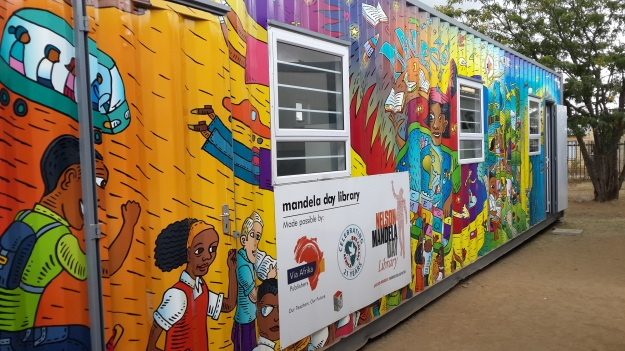 A discarded ship container is recycled into a children's library.