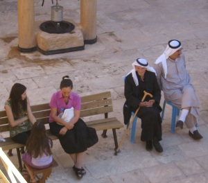 I (in pink) attempt to listen emphatically to Christians from Syria while sitting in a monastery courtyard in Southeast Turkey.