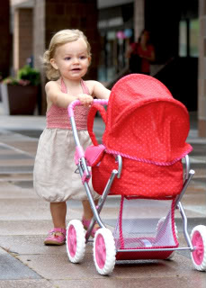 girl pushing stroller