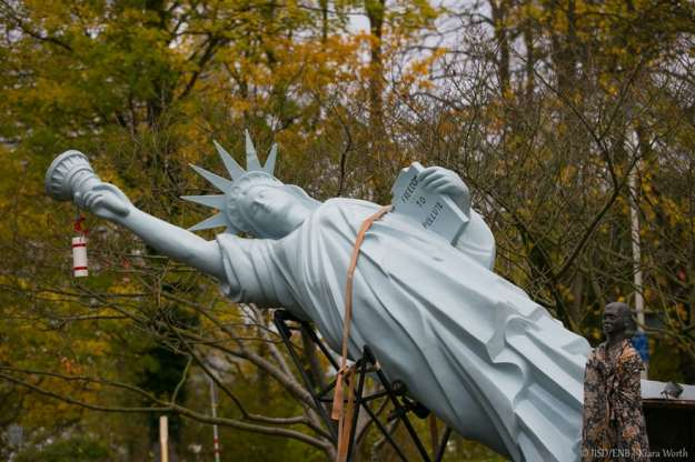 freedom to pollute with bronze statue of refugee